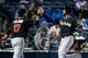 Jul 3, 2013; Atlanta, GA, USA; Miami Marlins second baseman Donovan Solano (17) celebrates with shortstop Adeiny Hechavarria (3) after scoring in the eighth inning against the Atlanta Braves at Turner Field. Mandatory Credit: Daniel Shirey-USA TODAY Sports