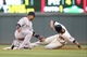 Jul 3, 2013; Minneapolis, MN, USA; Minnesota Twins outfielder Aaron Hicks (32) steals second base as New York Yankees second baseman Robinson Cano (24) applies a late tag during the fourth inning at Target Field. Mandatory Credit: Brace Hemmelgarn-USA TODAY Sports