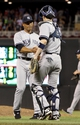 Jul 3, 2013; Minneapolis, MN, USA; New York Yankees pitcher Mariano Rivera (42) is congratulated by catcher Chris Stewart (19) following the game against the Minnesota Twins at Target Field. The Yankees defeated the Twins 3-2. Mandatory Credit: Brace Hemmelgarn-USA TODAY Sports