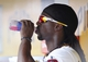 Jul 4, 2013; Pittsburgh, PA, USA; Pittsburgh Pirates center fielder Andrew McCutchen (22) hydrates in the dugout against the Philadelphia Phillies during the fourth inning at PNC Park. The Philadelphia Phillies won 6-4. Mandatory Credit: Charles LeClaire-USA TODAY Sports