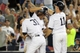 Jul 5, 2013; Bronx, NY, USA; New York Yankees left fielder Vernon Wells (12) is congratulated by right fielder Ichiro Suzuki (31) and center fielder Brett Gardner (11) after hitting a game-winning RBI single against the Baltimore Orioles during the ninth inning of a game at Yankee Stadium. Mandatory Credit: Brad Penner-USA TODAY Sports