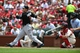 Jul 6, 2013; St. Louis, MO, USA; Miami Marlins first baseman Logan Morrison (5) hits a two run home run off of St. Louis Cardinals starting pitcher Joe Kelly (not pictured) during the third inning at Busch Stadium. Mandatory Credit: Jeff Curry-USA TODAY Sports