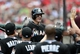 Jul 6, 2013; St. Louis, MO, USA; Miami Marlins second baseman Derek Dietrich (51) is congratulated by teammates after hitting a solo home run off of St. Louis Cardinals starting pitcher Joe Kelly (not pictured) during the fourth inning at Busch Stadium. Mandatory Credit: Jeff Curry-USA TODAY Sports