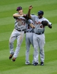 Jul 6, 2013; Cleveland, OH, USA; Detroit Tigers left fielder Andy Dirks (12) right fielder Torii Hunter (48) and center fielder Austin Jackson (14) celebrate a 9-4 over the Cleveland Indians at Progressive Field. Mandatory Credit: David Richard-USA TODAY Sports