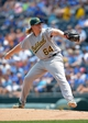 Jul 7, 2013; Kansas City, MO, USA; Oakland Athletics starting pitcher A.J. Griffin (64) delivers a pitch in the first inning of the game against the Kansas City Royals at Kauffman Stadium. Mandatory Credit: Denny Medley-USA TODAY Sports
