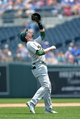 Jul 7, 2013; Kansas City, MO, USA; Oakland Athletics shortstop Jed Lowrie (8) fields a pop up infield fly ball in the first inning of the game against the Kansas City Royals at Kauffman Stadium. Mandatory Credit: Denny Medley-USA TODAY Sports