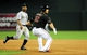 Jul 7, 2013; Phoenix, AZ, USA; Arizona Diamondbacks base runner Eric Chavez (12) is caught in a pickle during the fifth inning during a game against the Colorado Rockies at Chase Field. Mandatory Credit: Jennifer Hilderbrand-USA TODAY Sports