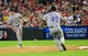 Jul 7, 2013; Phoenix, AZ, USA; Colorado Rockies first baseman Jordan Pacheco (15) throws the ball to pitcher Rex Brothers (49) in the eighth inning during a game against the Arizona Diamondbacks at Chase Field. Mandatory Credit: Jennifer Hilderbrand-USA TODAY Sports
