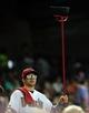 Jul 7, 2013; Phoenix, AZ, USA; Arizona Diamondbacks fan holds up a broom during the ninth inning during a game against the Colorado Rockies at Chase Field. Mandatory Credit: Jennifer Hilderbrand-USA TODAY Sports