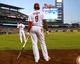 Jul 8, 2013; Philadelphia, PA, USA; Philadelphia Phillies second baseman Chase Utley (26) and left fielder Domonic Brown (9) wait for the start of  the fifth inning against the Washington Nationals at Citizens Bank Park. The Phillies defeated the Nationals, 3-2. Mandatory Credit: Eric Hartline-USA TODAY Sports