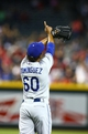 Jul. 8, 2013; Phoenix, AZ, USA: Los Angeles Dodgers pitcher Jose Dominguez celebrates following the game against the Arizona Diamondbacks at Chase Field. The Dodgers defeated the Diamondbacks 6-1. Mandatory Credit: Mark J. Rebilas-USA TODAY Sports