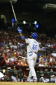 Jul. 8, 2013; Phoenix, AZ, USA: Los Angeles Dodgers outfielder Yasiel Puig throws his bat in the air after a strike in the eighth inning against the Arizona Diamondbacks at Chase Field. Mandatory Credit: Mark J. Rebilas-USA TODAY Sports