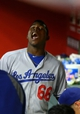 Jul. 8, 2013; Phoenix, AZ, USA: Los Angeles Dodgers outfielder Yasiel Puig reacts in the dugout against the Arizona Diamondbacks at Chase Field. Mandatory Credit: Mark J. Rebilas-USA TODAY Sports