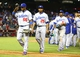 Jul. 8, 2013; Phoenix, AZ, USA: Los Angeles Dodgers outfielder Yasiel Puig (66) celebrates with teammates following the game against the Arizona Diamondbacks at Chase Field. Mandatory Credit: Mark J. Rebilas-USA TODAY Sports