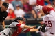 Jul 9, 2013; Philadelphia, PA, USA; Washington Nationals catcher Kurt Suzuki (24) looses the ball while tagging Philadelphia Phillies second baseman Chase Utley (26) during the fourth inning at Citizens Bank Park. Mandatory Credit: Howard Smith-USA TODAY Sports