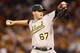 Jul 9, 2013; Pittsburgh, PA, USA; Oakland Athletics starting pitcher Dan Straily (67) delivers a pitch against the Pittsburgh Pirates during the first inning at PNC Park. Mandatory Credit: Charles LeClaire-USA TODAY Sports