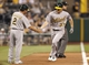Jul 9, 2013; Pittsburgh, PA, USA; Oakland Athletics third base coach Mike Gallego (2) greets first baseman Brandon Moss (37) after Moss hit a two run home run against the Pittsburgh Pirates during the fourth inning at PNC Park. The Oakland Athletics won 2-1. Mandatory Credit: Charles LeClaire-USA TODAY Sports