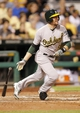 Jul 9, 2013; Pittsburgh, PA, USA; Oakland Athletics shortstop Jed Lowrie (8) singles against the Pittsburgh Pirates during the sixth inning at PNC Park. The Oakland Athletics won 2-1. Mandatory Credit: Charles LeClaire-USA TODAY Sports