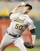 Jul 9, 2013; Pittsburgh, PA, USA; Oakland Athletics relief pitcher Grant Balfour (50) pitches against the Pittsburgh Pirates during the ninth inning at PNC Park. The Oakland Athletics won 2-1. Mandatory Credit: Charles LeClaire-USA TODAY Sports