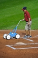 Jul 8, 2013; Cleveland, OH, USA; A member of the Cleveland Indians grounds crew works at home plate during a game between the Cleveland Indians and the Detroit Tigers at Progressive Field. Detroit won 4-2. Mandatory Credit: David Richard-USA TODAY Sports