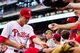 Jul 10, 2013; Philadelphia, PA, USA; Philadelphia Phillies second baseman Chase Utley (26) signs autographs prior to playing the Washington Nationals at Citizens Bank Park. The Nationals defeated the Phillies 5-1. Mandatory Credit: Howard Smith-USA TODAY Sports