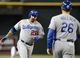 Jul 10, 2013; Phoenix, AZ, USA;  Los Angeles Dodgers infielder Adrian Gonzalez (23) is congratulated by third base coach Tim Wallach (26) after hitting a solo home run against the Arizona Diamondbacks in the seventh inning at Chase Field. Mandatory Credit: Jennifer Stewart-USA TODAY Sports