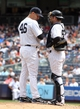 Jul 11, 2013; Bronx, NY, USA; New York Yankees starting pitcher Andy Pettitte (46) talks with catcher Austin Romine (53) on the mound during the fifth inning of a game against the Kansas City Royals at Yankee Stadium. Mandatory Credit: Brad Penner-USA TODAY Sports