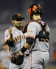 Jul 11, 2013; San Diego, CA, USA; San Francisco Giants relief pitcher Sergio Romo (54) celebrates with catcher Buster Posey (28) after a 4-2 win against the San Diego Padres at Petco Park. Mandatory Credit: Christopher Hanewinckel-USA TODAY Sports
