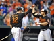 Jul 12, 2013; Baltimore, MD, USA; Baltimore Orioles first baseman Chris Davis (19) is congratulated by Matt Wieters (32) after hitting a two-run home run in the second inning against the Toronto Blue Jays at Oriole Park at Camden Yards. Mandatory Credit: Joy R. Absalon-USA TODAY Sports