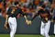 Jul 12, 2013; Baltimore, MD, USA; Baltimore Orioles teammates J.J. Hardy (2) and Nick Markakis (21) celebrate after a game against the Toronto Blue Jays at Oriole Park at Camden Yards. The Orioles defeated the Blue Jays 8-5. Mandatory Credit: Joy R. Absalon-USA TODAY Sports