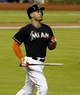 Jul 12, 2013; Miami, FL, USA;  Miami Marlins right fielder Giancarlo Stanton carries his broken bat after popping out in the eighth inning against the Washington Nationals at Marlins Park. The Marlins won 8-3.  Mandatory Credit: Robert Mayer-USA TODAY Sports