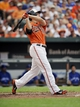 Jul 13, 2013; Baltimore, MD, USA; Baltimore Orioles first baseman Chris Davis (19) hits a solo home run in the second inning against the Toronto Blue Jays at Oriole Park at Camden Yards. Mandatory Credit: Joy R. Absalon-USA TODAY Sports