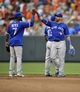 Jul 13, 2013; Baltimore, MD, USA; Toronto Blue Jays shortstop Jose Reyes (7) and right fielder Jose Bautista (19) celebrate after a game against the Baltimore Orioles at Oriole Park at Camden Yards. The Blue Jays defeated the Orioles 7-3. Mandatory Credit: Joy R. Absalon-USA TODAY Sports