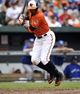 Jul 13, 2013; Baltimore, MD, USA; Baltimore Orioles center fielder Adam Jones (10) is brushed back by a pitch in the eighth inning against the Toronto Blue Jays at Oriole Park at Camden Yards. The Blue Jays defeated the Orioles 7-3. Mandatory Credit: Joy R. Absalon-USA TODAY Sports