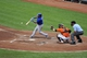 Jul 13, 2013; Baltimore, MD, USA; Toronto Blue Jays second baseman Maicer Izturis (3) hits an infield single in the fourth inning against the Baltimore Orioles at Oriole Park at Camden Yards. The Blue Jays defeated the Orioles 7-3. Mandatory Credit: Joy R. Absalon-USA TODAY Sports