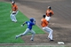 Jul 13, 2013; Baltimore, MD, USA; Toronto Blue Jays second baseman Maicer Izturis (3) is safe at first base on an infield single as Baltimore Orioles pitcher Jason Hammel (39) can't make the play in the sixth inning at Oriole Park at Camden Yards. The Blue Jays defeated the Orioles 7-3. Mandatory Credit: Joy R. Absalon-USA TODAY Sports
