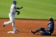 Jul 13, 2013; Cleveland, OH, USA; Kansas City Royals second baseman Miguel Tejada (left) turns a double play over Cleveland Indians designated hitter Jason Giambi (25) in the second inning at Progressive Field. Mandatory Credit: David Richard-USA TODAY Sports