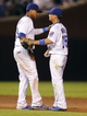 Jul 13, 2013; Chicago, IL, USA; Chicago Cubs shortstop Starlin Castro (left) and Chicago Cubs second baseman Darwin Barney (right) celebrate the last out of the ninth inning against the St. Louis Cardinals at Wrigley Field. The Cubs won 6-4. Mandatory Credit: Dennis Wierzbicki-USA TODAY Sports