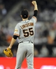 Jul 13, 2013; San Diego, CA, USA; San Francisco Giants starting pitcher Tim Lincecum (55) reacts after a diving catch by right fielder Hunter Pence (not pictured) during the eighth inning against the San Diego Padres at Petco Park. Mandatory Credit: Christopher Hanewinckel-USA TODAY Sports