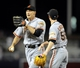 Jul 13, 2013; San Diego, CA, USA; San Francisco Giants right fielder Hunter Pence (8) is congratulated by starting pitcher Tim Lincecum (55) after a diving catch during the eighth inning against the San Diego Padres at Petco Park. Mandatory Credit: Christopher Hanewinckel-USA TODAY Sports