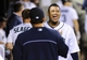 Jul 13, 2013; Seattle, WA, USA; Seattle Mariners starting pitcher Felix Hernandez (34) smiles in the dugout during bottom of the 8th inning against the Los Angeles Angels at Safeco Field. Mandatory Credit: Steven Bisig-USA TODAY Sports