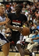 Jul 13, 2013; Las Vegas, NV, USA; Chicago Bulls guard Tony Snell eyes the basket while turning the corner on Memphis Grizzlies forward Janis Timma during the first quarter of an NBA Summer League game at Cox Pavillion. Mandatory Credit: Stephen R. Sylvanie-USA TODAY Sports