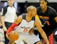 Jul 14, 2013; Las Vegas, NV, USA; Washington Wizards guard Sundiata Gaines dribbles the ball while backing in to New York Nicks guard Toure Murry during an NBA Summer League game at Cox Pavillion. Mandatory Credit: Stephen R. Sylvanie-USA TODAY Sports