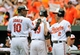 Jul 14, 2013; Baltimore, MD, USA; Baltimore Orioles center fielder Adam Jones (10) is congratulated by J.J. Hardy (2) after scoring on a two-run home run by Chris Davis (19) in the third inning against the Toronto Blue Jays at Oriole Park at Camden Yards. Mandatory Credit: Joy R. Absalon-USA TODAY Sports