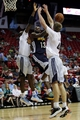 Jul 18, 2013; Las Vegas, NV, USA; Memphis Grizzlies forward Donte Green looks to score between defending Charlotte Bobcats centers Bismack Biyombo, left, and Cody Zeller during an NBA Summer League game at the Thomas and Mack Center . Mandatory Credit: Stephen R. Sylvanie-USA TODAY Sports