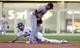 Jul 19, 2013; Kansas City, MO, USA; Detroit Tigers second baseman Ramon Santiago (39) can't make the tag as Kansas City Royals left fielder Alex Gordon (4) safely steals second base in the first inning at Kauffman Stadium. Mandatory Credit: Denny Medley-USA TODAY Sports