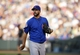 Jul 20, 2013; Denver, CO, USA; Chicago Cubs pitcher Carlos Villanueva (33) walks off the field after the third inning against the Colorado Rockies at Coors Field. Mandatory Credit: Chris Humphreys-USA TODAY Sports