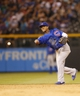 Jul 20, 2013; Denver, CO, USA; Chicago Cubs shortstop Starlin Castro (13) fields a ground ball during the seventh inning against the Colorado Rockies at Coors Field. Mandatory Credit: Chris Humphreys-USA TODAY Sports