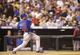 Jul 20, 2013; Denver, CO, USA; Chicago Cubs second baseman Darwin Barney (15) hits a single during the seventh inning against the Colorado Rockies at Coors Field. Mandatory Credit: Chris Humphreys-USA TODAY Sports