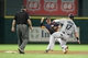 Jul 21, 2013; Houston, TX, USA; Seattle Mariners first baseman Justin Smoak (17) is out at second base as Houston Astros shortstop baseman Jake Elmore (10) throws to first base during the fifth inning at Minute Maid Park. Mandatory Credit: Troy Taormina-USA TODAY Sports